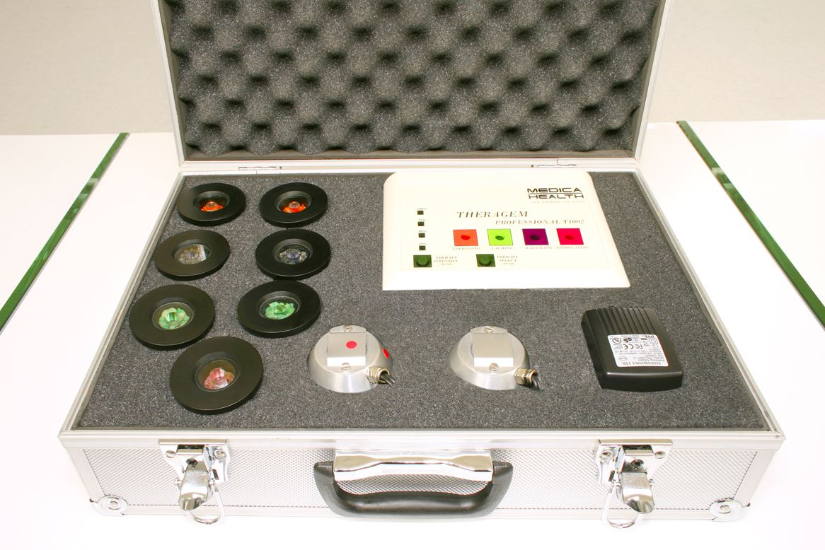 photo of theragem professional T1002 gem lamp machine in it's metal flight case with all 7 gem cups