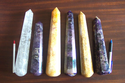 photo - 6 different quartz crystal wands (clear, amethyst and citrine)