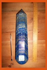 picture of a large crystal wand on a wooden table